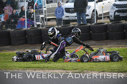 Image - Darcy Stonehouse, #27, and Akasha McEachran, #57, tangle in Cadet 12. 
