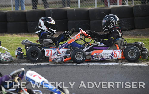 Image - Darcy Stonehouse, #27, and Akasha McEachran, #57, tangle in Cadet 12. Round four of the Victorian Country Series at Wimmera Kart Club  at Dooen.