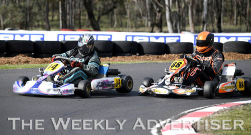 Image - Greg Ord, #14, and Aaron Sutherland, #88, tussle in TAG 125 retricted medium class. Round four of the Victorian Country Series at Wimmera Kart Club  at Dooen.