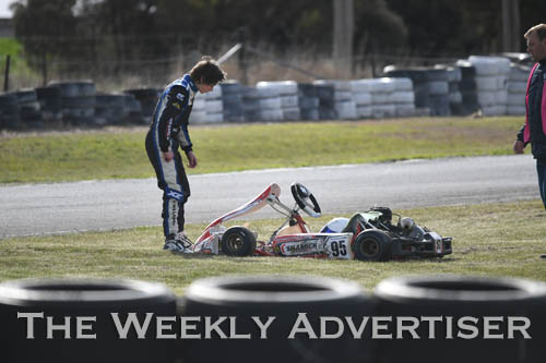 Image - Nathan Williams retrieves his kart after spinning out.Round four of the Victorian Country Series at Wimmera Kart Club  at Dooen.
