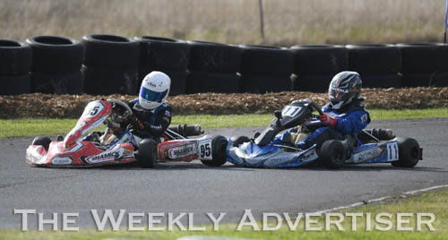 Image - Nathan Williams, #95, gets bumped out of the race by Hamish Allan.Round four of the Victorian Country Series at Wimmera Kart Club  at Dooen.